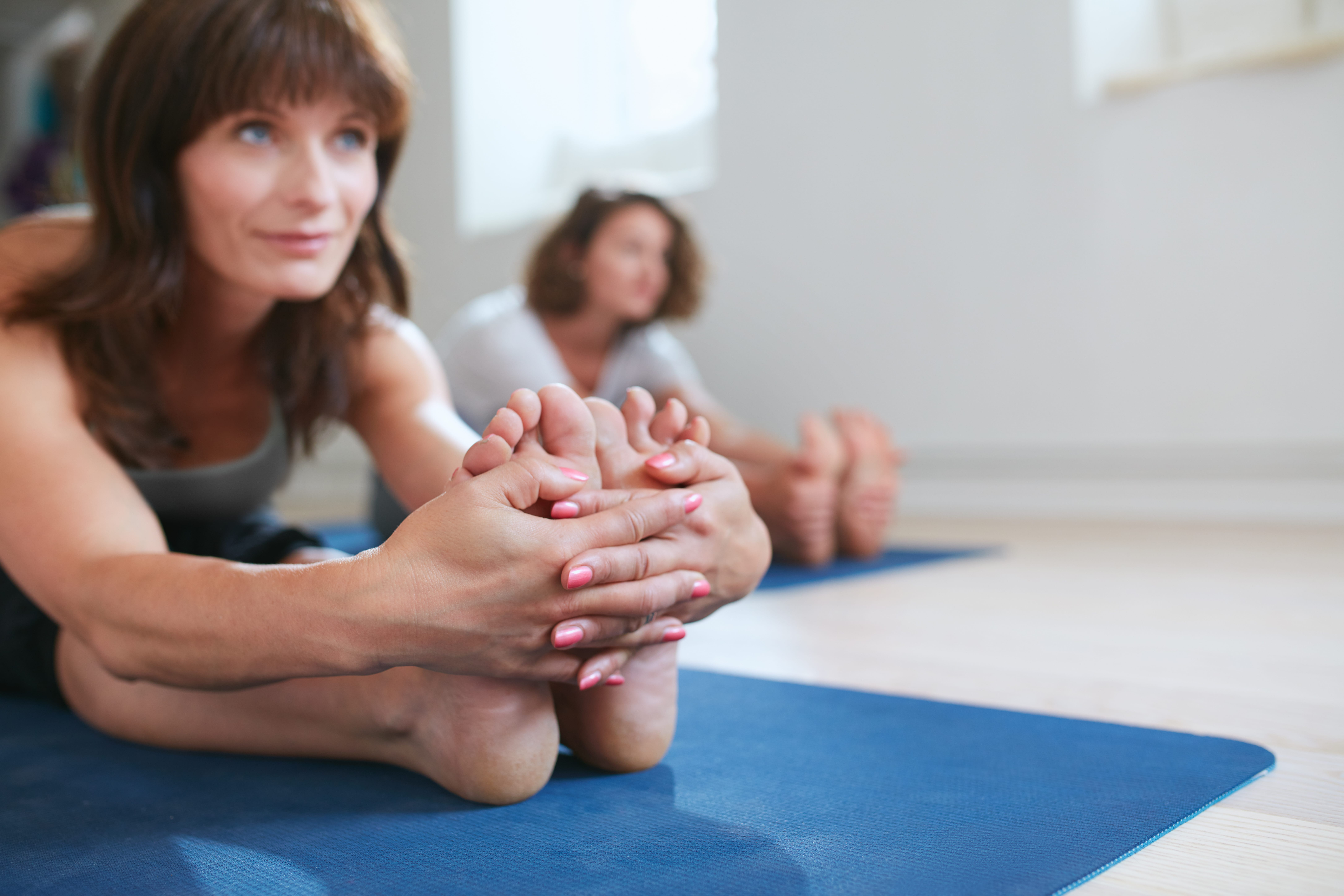 Women Stretching Together At Yoga Class Coral Calcium